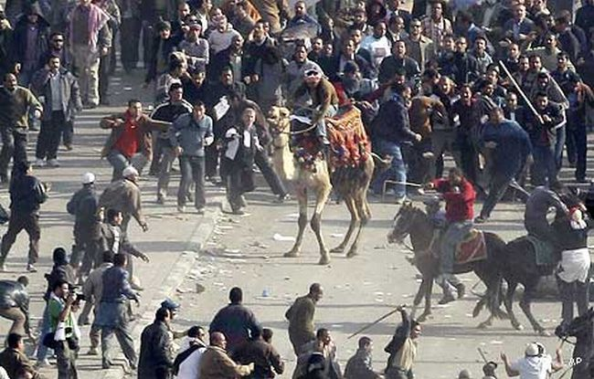 Baton & metal bar wielding paid thugs on camels and horses